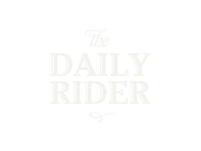 The Daily Rider bike shop logo on forest green background